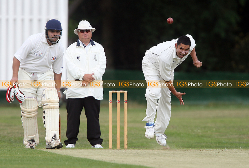 S Saeed of Wanstead in bowling action - Ilford CC vs Wanstead CC - Essex Cricket League - 02/07/11 - MANDATORY CREDIT: Rob Newell/TGSPHOTO - Self billing applies where appropriate - 0845 094 6026 - contact@tgsphoto.co.uk - NO UNPAID USE.