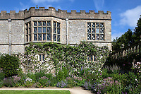 Facade of Haddon Hall from the Lower Garden with summer border