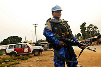 LIBERIA, Monrovia, 05/04/2007..Christlina on Joint Task Force patrol in the Duport Road area of Monrovia. The unit provides essential armed back up to the fledging Liberian National Police force...© 2007 Aubrey Wade. All rights reserved.