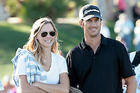 24 January 2009: Celebrity golfer Oliver Hudson with wife Erin Bartlett walking the cart path together to the 18th hole at Palmer Private at PGA West in La Quinta, California during the fourth round of play at the 50th Bob Hope Classic, PGA golf tournament.