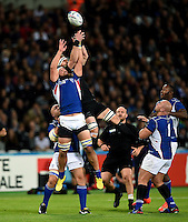 Pieter-Jan van Lill of Namibia and Kieran Read of New Zealand compete for the ball in the air. Rugby World Cup Pool C match between New Zealand and Namibia on September 24, 2015 at The Stadium, Queen Elizabeth Olympic Park in London, England. Photo by: Patrick Khachfe / Onside Images