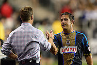 Philadelphia Union manager John Hackworth greets Daniel Cruz (44) as he is subbed out of the match. The Philadelphia Union defeated D. C. United 2-0 during a Major League Soccer (MLS) match at PPL Park in Chester, PA, on August 10, 2013.