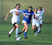 Laura Weinberg (16) of Duke tries to keep up with Emily Carrollo (19) of Virginia during the game at Klockner Stadium in Charlottesville, VA.  Virginia defeated Duke, 1-0.