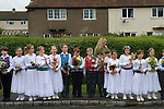 Charlton-on-Otmoor Oxfordshire May Day Celebrations. Children from the Church of England St Mary the Virgin Primary School process to the village church to have their May garlands blessed. They sing the traditional May Day song twice on route and once outside of the church.2014.