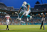 Miami Dolphins wide receiver Rishard Matthews (18) and tight end Jordan Cameron (84) celebrate Matthews touchdown in the second quarter during the Miami Dolphins' exhibition game against the Atlanta Falcons at Sun Life Stadium on Saturday, August 29, 2015.