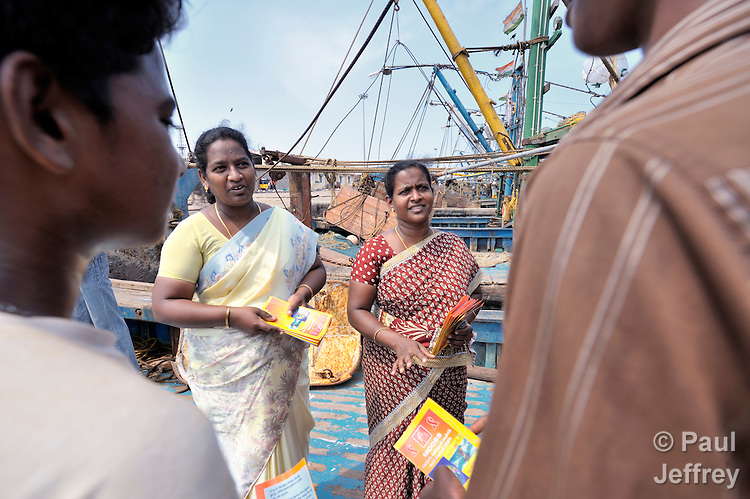 Glory Premlatha (left) and Beulah Kalaiselvi, educators with the Madras Christian Council of Social Service, meet with fisherfolk on their boats in the port of Chennai, India, to explain HIV and AIDS and how HIV can be transmitted.