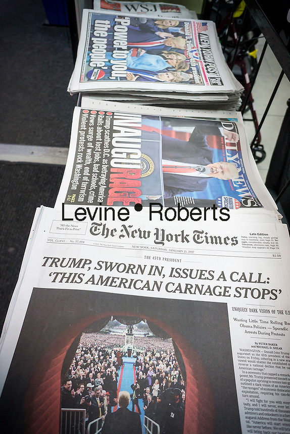 New York newspapers on Saturday, January 21, 2017 to report on the previous days' Donald Trump inauguration.   (© Richard B. Levine)