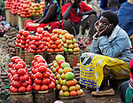 A woman selling tomatoes in a market in Dedza, Malawi, along the border with Mozambique.