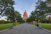 Looking north across the Great Walk to the steps of the State Capitol in Austin, Texas, this is the morning view you'll enjoy. Under a canopy of trees, this historic walkway leads to the front doors. Stroll around and enjoy the quiet on an early Saturday morning.