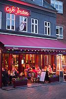 Diners eating al fresco at Cafe Jorden, a pavement cafeteria in Lille Torvet square in old Latin Quarter of  Aarhus, Denmark