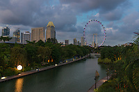 Singapore skyline in the evening with ferris wheel Flyer and Dragonfly lake near Gardens By The Bay, Singapore
