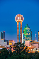 This is the cityscape view of the Dallas Reunion Tower at night in the downtown area of the city.  You can see the mirrored Hyatt Regency and Fountain place in the frame against the dark sky.