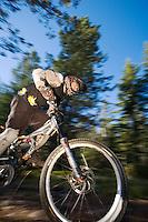 Dave Fafard accelerates on mountain bike, Alberta, Canada