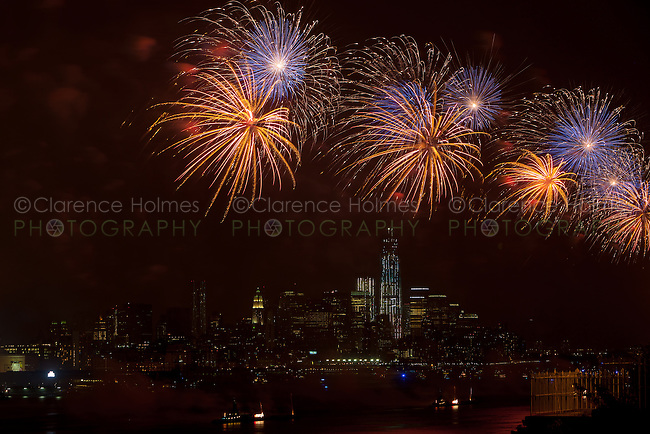 The Macy's Fourth of July fireworks extravaganza lights the sky over New York City and the Hudson river on Wednesday, July 4, 2012 as seen from Weehawken, New Jersey on the west side of the river looking south toward the rising Freedom Tower (One World Trade Center) and lower Manhattan.  The fireworks show, held annually, celebrates the United States Independence day of July 4th.