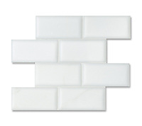 3&quot; x 6&quot; Bricks shown in pillowed and honed Paperwhite are part of New Ravenna's Studio Line. All mosaics in this collection are ready to ship within 48 hours.<br />