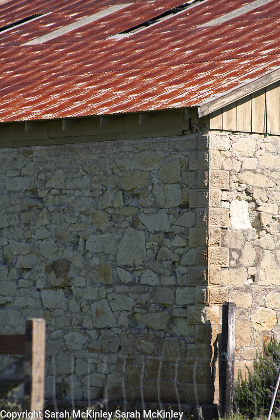 A detail of the walls of an old stone barn on Highway 128 between Geyserville and Calistoga in Napa County in Northern California.