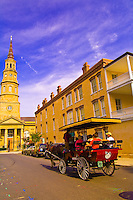 A carriage tour rides down Church Street with St. Philip's Episcopal Church in background in the historic district of Charleston, South Carolina