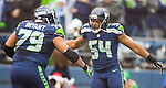 Seattle Seahawks linebacker Bobby Wagner (54) celebrates with Red Bryant (79) after sacking Arizona Cardinals quarterback Carson Palmer in the third quarter at CenturyLink Field in Seattle, Washington on December 22, 2013.   Wagner also interception a Palmer pass in the Cardinals 17-10 win over the Seahawks. ©2013. Jim Bryant Photo. ALL RIGHTS RESERVED.
