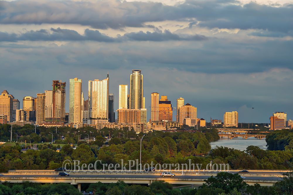 This was taken as a storm clouds were approaching Austin from the east but the sun was shinning brightly on the buildings so that the skyline reflected back a golden glow over the city.  This photo show downtown austin and Ladybird Lake  as the storm move in.