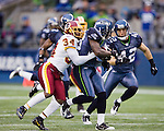 Seattle Seahawks kickoff return specialist Leon Washington is run down by Washington Redskins Byron Westbrook after returning a kickoff for 51-yards during the third quarter at  CenturyLink Field in Seattle, Washington on November 27, 2011. Redskins stunned the Seattle Seahawks 23-17.  ©2011 Jim Bryant Photo. All Rights Reserved.