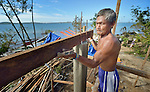 Rolando Penagonda builds the framework of a new house three months after he lost his old one to Typhoon Haiyan, which ravaged a wide swath of the Philippines in November 2013. He lives on Manipulon, a small island off the coast from the town of Estancia. The storm was known locally as Yolanda. Residents of this island have received some assistance from the ACT Alliance.