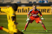 Philadelphia Union goalkeeper Zac MacMath (18) watches Dominic Oduro (11) of the Columbus Crew. The Philadelphia Union defeated the Columbus Crew 3-0 during a Major League Soccer (MLS) match at PPL Park in Chester, PA, on June 5, 2013.