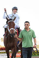 Doubles Partner with jockey Julien Leparoux after winning the Canadian Turf(G3T) at Gulfstream Park. Hallandale Beach, Florida. 03-03-2012