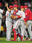 29 September 2010: Philadelphia Phillies' catcher Paul Hoover gets high-fives from teammates after a game against the Washington Nationals at Nationals Park in Washington, DC. The Phillies defeated the Nationals 7-1 to take the rubber game of their 3-game series. Mandatory Credit: Ed Wolfstein Photo