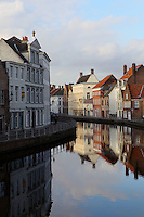 BRUGES, BELGIUM - FEBRUARY 06 : A general view of a canal on February 06, 2009 in Bruges, West Flanders, Belgium. The bright colors of the residential houses along the canal are reflected in the cool water.(Photo by Manuel Cohen)