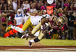 Notre Dame cornerback Cole Luke, left, rides Florida State wide receiver Rashad Greene into the endzone for a touchdown in the second half of an NCAA college football game in Tallahassee, Fla., Saturday, Oct. 18, 2014.  AP Photo/Mark Wallheiser)