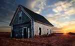 A farmhouse sits buried under a newly deposited layer of fill in Prince Edward Island.
