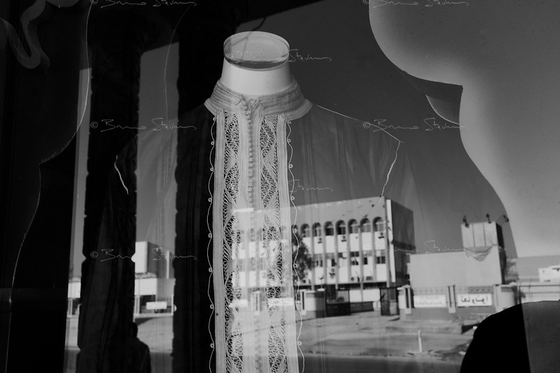 Beni Walid, Libya, June 25, 2011..Picture taken during a government organized trip. The city tribunal is reflected in a shop window..