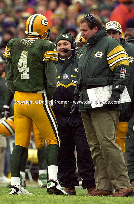 Green Bay Packers Quarterback Brett Favre and Coach Mike Holmgren discuss a play during the December 8, 1996 against the Denver Broncos at Lambeau Field. Favre threw for 4 touchdowns as the Pack won the contest 41-6.