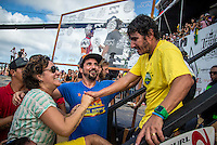 Pipeline, North Shore of Oahu, Hawaii Friday December 19 2014) Charlie Medina (BRA), Simone Medina (BRA) greet after Gabriel has won the World Title. Medina is being interviewed in the background.. - The final stop of the 2014  World Championship Tour, the Billabong Pipe Masters in Memory of Andy Irons, was  ccompleted today in NW double overhead surf. <br /> Gabriel Medina (BRA) became the first ever Brazilian World Champion after both rival contenders , Kelly Slater (USA) and Mick Fanning (AUS) were eliminated from the contest. Medina went onto finish 2nd overall behind Julian Wilson (AUS). <br /> In the overlapping heat format Wilson surf three consequent heats and still had enough entry to take out the 30 minute final.<br /> By winning the final Wilson also won the covered Vans Triple Crown of Surfing for best overall performance through the whole Triple Crown.<br /> <br /> The Billabong Pipe Masters in Memory of Andy Irons will determine this year&rsquo;s world surfing champion as well as those who qualify for the elite tour in 2015. As the third and final stop on the Vans Triple Crown of Surfing Series  the event will also determine the winner of the revered three-event leg.<br /> <br />  Photo: joliphotos.com