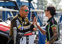 Sep 25, 2016; Madison, IL, USA; NHRA top fuel driver Tony Schumacher (left) with funny car driver Alexis DeJoria during the Midwest Nationals at Gateway Motorsports Park. Mandatory Credit: Mark J. Rebilas-USA TODAY Sports