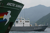 GREENPEACE SHIP 'ARCTIC SUNRISE', AND INFLATABLES, PROTEST IN UCHIURA BAY, BESIDE THE TAKAHAMA NUCEAR PLANT, AS BNFL SHIP 'PACIFIC PINTAIL' ARRIVES EARLY MORNING FOR RETRIEVAL OF REJECTED PLUTONIUM MOX FUEL, FOR SHIPMENT BACK TO THE UNITED KINDOM. TAKAHAMA, JAPAN. 04/07/02. .PIC &copy; JEREMY SUTTON-HIBBERT/GREENPEACE 2002..*****ALL RIGHTS RESERVED. RIGHTS FOR ONWARD TRANSMISSION OF ANY IMAGE OR FILE IS NOT GRANTED OR IMPLIED. CHANGING COPYRIGHT INFORMATION IS ILLEGAL AS SPECIFIED IN THE COPYRIGHT, DESIGN AND PATENTS ACT 1988. THE ARTIST HAS ASSERTED HIS MORAL RIGHTS. *******