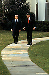 King Hussein of Jordan walks along a path of the South Lawn at the White House with President Reagan on December 20, 1982.