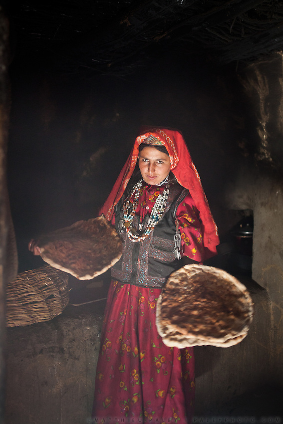 Wakhi women cooking in a house in Sarhad village, inhabited by Wakhis people. It is the end of the jeepable road in the Wakhan corridor, and the beginning of the trek up to the Little Pamir where the Afghan Kyrgyz live.
