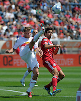 New York midfielder Teemu Tainio (2) clears the ball in front of Chicago midfielder Baggio Husidic (9).  The Chicago Fire tied the New York Red Bulls 1-1 at Toyota Park in Bridgeview, IL on June 26, 2011.
