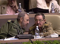 Cuban President Fidel Castro, with brother and Cuba's Minister of Defense, Raul Castro, pictured on September 1, 2005 during a Cuban Parliament session. Credit: Jorge Rey/MediaPunch