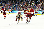 07 APR 2012:  Steven Whitney (21) of Boston College stretches for the puck against Ferris State University during the Division I Men's Ice Hockey Championship held at the Tampa Bay Times Forum in Tampa, FL.  Boston College defeated Ferris State 4-1 to win the national title.  Matt Marriott/NCAA Photos