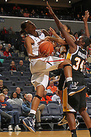 Dec. 18, 2010; Charlottesville, VA, USA; Virginia Cavaliers forward Telia McCall (30) is defended by UMBC Retrievers guard Kristin Coles (22) and UMBC Retrievers center Topé Obajolu (34) as she tries to shoot a basket during the game at the John Paul Jones Arena. Virginia won 61-46. Mandatory Credit: Andrew Shurtleff