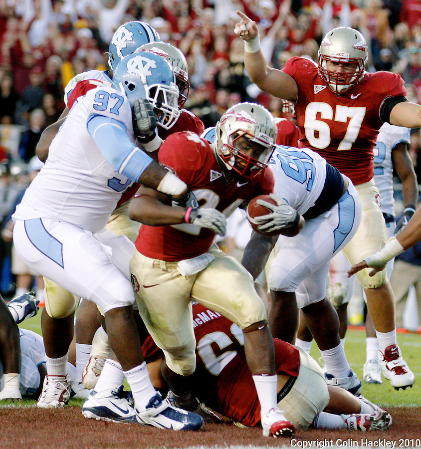 TALLAHASSEE, FL 11/6/10-FSU-NC FB10 CH-Florida State's Lonnie Pryor spins into the endzone for the Seminole's final touchdown against North Carolina during second half action Saturday at Doak Campbell Stadium in Tallahassee. The Seminoles lost to the Tar Heels 37-35..COLIN HACKLEY PHOTO