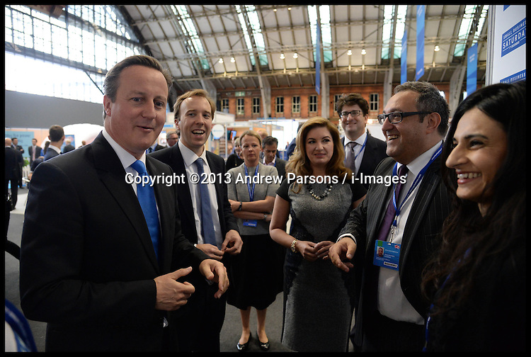The Prime Minister David Cameron Karren Brady and Matthew Hancock  visit the Small Business Saturday Stand at the Conservative Party Conference in Manchester, United Kingdom. Monday, 30th September 2013. Picture by Andrew Parsons / i-Images