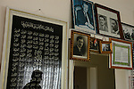 Pictures of Arab leaders are hung on a wall at Sheikh Abu Adnan's house, in Majdal Shams, Golan Heights.