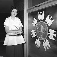 Elna 'lights' painting at Lutheran Church 1959