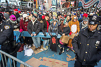 """Crowds pack Times Square in New York on Monday, December 31, 2012, the afternoon of New Year's Eve. Temperatures for the celebration are expected to drop below freezing but remain dry with over a million people packing the """"Crossroads of the World"""" celebrating the incoming 2013. (© Richard B. Levine)"""