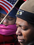 Photo by Phil Grout..Tears trickle down the cheek of Bridgette Wright of Dacula, Georgia,.as her daughter, Leah holds an American flag during the opening prayer.of the inauguration of Barrack Obama..