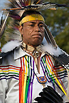 D.Salvatore Timerwolf Lamia dressing in traditional regalia, Tribal Ancestry: Shinnecock Indian Nation, Paukatuck Eastern Pequot. Inter tribal Dancing a celebration of ethnic Native American pride and heritage  at Thunderbird Pow Wow..release <br /> <br /> 2276, # 2452 <br /> <br /> A pow-wow (also powwow or pow wow or pau wau) is a gathering of North America's Native people. The word derives from the Narragansett word powwaw, meaning &quot;spiritual leader&quot;.