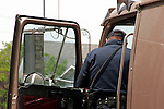A police representative gathering information for a report on a traffic accident from the driver of the semi big rig trailer in Wisconsin